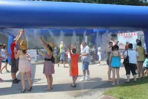 With temperatures in the low to mid 90s, this cooling area has been setup near the Point State Park tunnel.