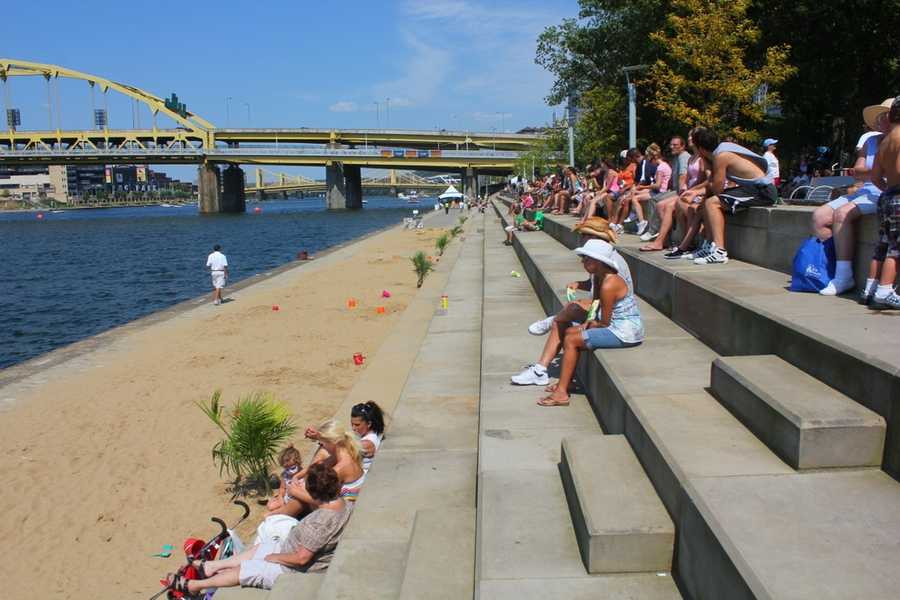 Sand on the River Steps? This is Beach 'Burgh, an area complete with sand, palm trees and kids toys.