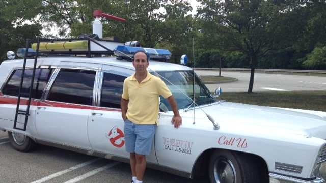 Bob Shapiro poses for a photo with his very own Ecto-1
