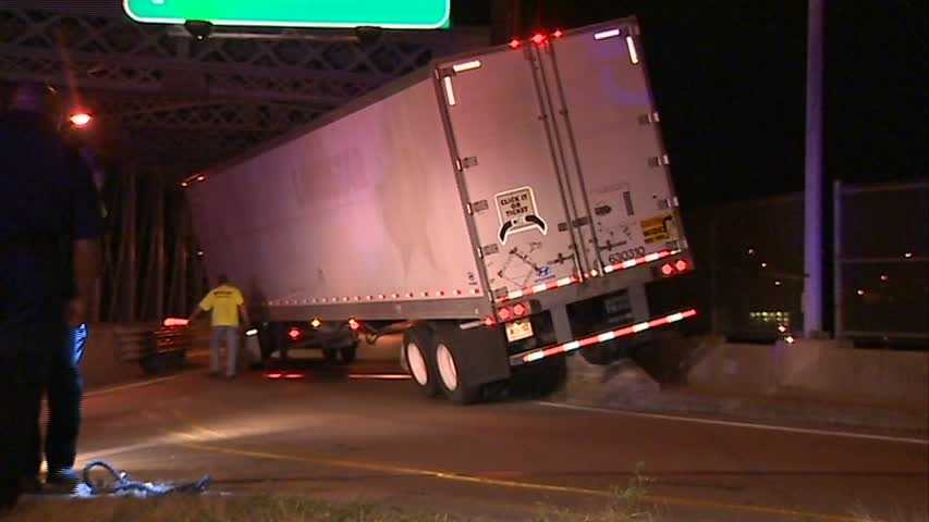 A tow truck had to haul away a tractor-trailer that became stuck on the Duquense-McKeesport bridge early Friday morning.