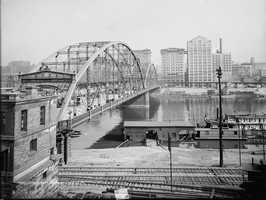 A look at the Sixth Street Bridge (now known as the Roberto Clemente Bridge). The photo was taken from the area PNC Park is located today.