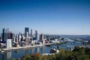 A look at the skyline of the city of Pittsburgh from approximately 2005. Note the lack of any river trail along the Mon Wharf.