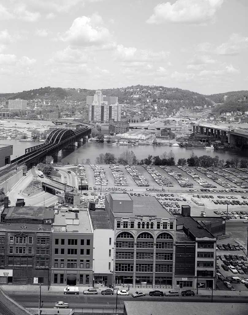1980s - A look toward the North Shore of Pittsburgh from the area currently occupied by the Greyhound Bus Station parking garage.  Note the demolition of part of the train bridge at the bottom of this photo, and the construction of Interstate 279 on the North Shore.