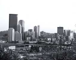A look at the skyline of the city of Pittsburgh from the city's North Side during the 1980s.The Veterans Bridge (I-579) is still under construction.