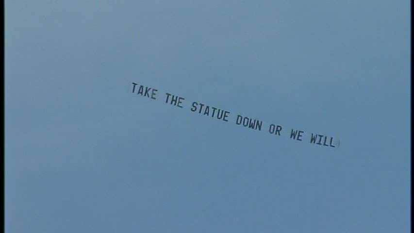 "A plane flew this banner over Beaver Stadium: ""Take the statue down or we will"""
