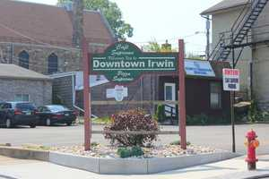 """Today, the area where the hotel once stood is a parking lot, with this """"Welcome to Irwin"""" sign."""