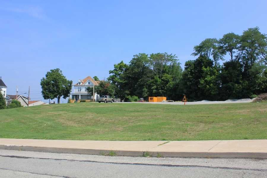 A look at the site where the school once stood. As of June 2012, the area remained an open, grassy field.