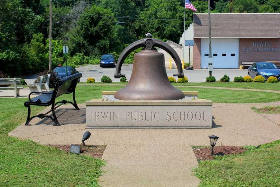 This Irwin Public School bell sits on the location of what was once the area's public library.