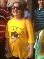 A Batman fan wears a T-shirt of the fictional Rogues football team.