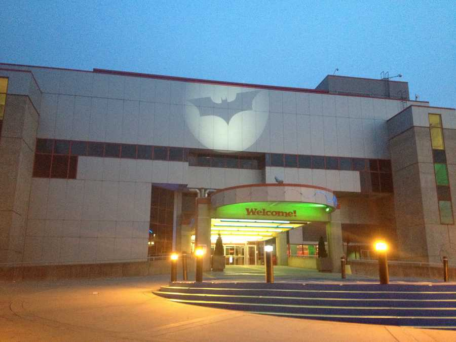 A spotlight shines the Bat-Signal on the Carnegie Science Center.
