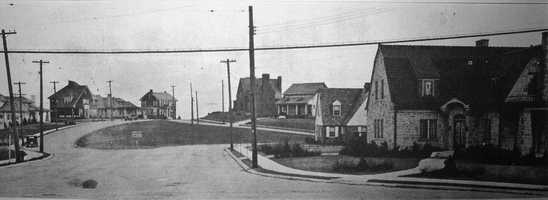 In the 1920s, F.E. McGillick purchased about 100 acres to develop the Lebanon Hills Plan. Lot sizes and architectural styles varied along the rolling hills. This picture shows Main Entrance to the left&#x3B; Lebanon Hills Drive goes off to the right.
