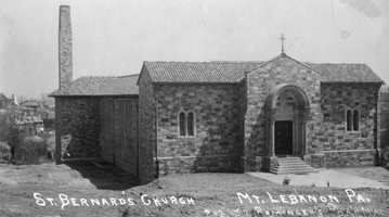 St. Bernard Church held its first mass in a Washington Road carriage house on August 31, 1919. Later that year the diocese purchased land on Washington Road and plans were hired to design a church, school, and rectory. Construction took decades to complete as temporary buildings, such as this one that was later replaced by the school, were erected and razed between 1920 and 1962 when the project was finally completed.