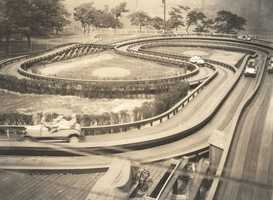 The Auto Race, also known as the Auto Ride, was opened in 1930, and features electric cars that run through a trough-like wooden track that twists and turns. When the ride opened in 1930, it had several small hills placed in the track (see top left area). Reports say they were removed soon after due to rear-end collisions caused when cars couldn't get up and over them on rainy days.