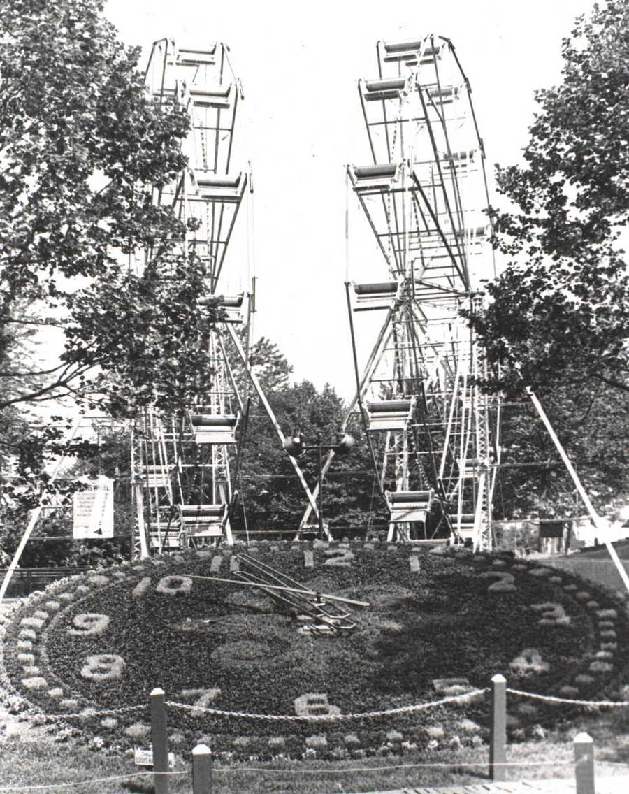 The clock still exists, but the twin Ferris Wheels have since been removed from the park.