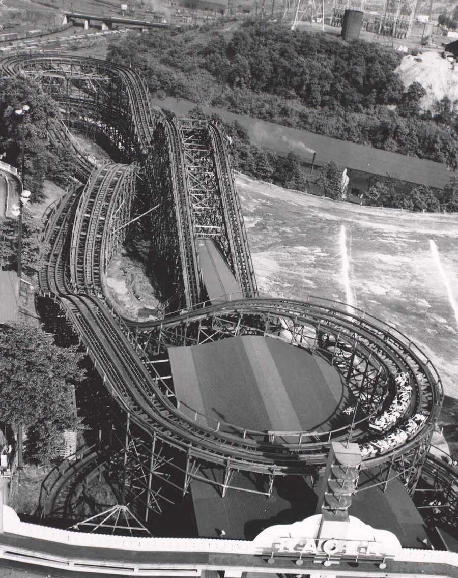 "An aerial photo of ""The Racer"" - a twin track-racing coaster, built by the Ingersoll Brothers in 1910, and costing nearly $50,000. It was the largest racing coaster in the world when built. The original ""Racer"" was torn down in 1910, and the current ""Racer"" we all know was put up in its place."
