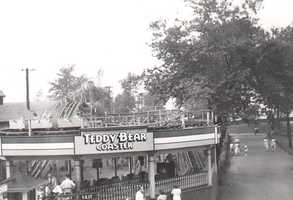 The Teddy Bear Coaster was built in 1935, and was a small Kiddie Coaster. Over 21,133 board feet of lumber were used. The trains consisted of three two-seat cars. The ride closed in 1947.