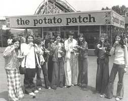 """The famous """"potato patch"""" in the center of Kennywood, where French fries are served in a basket with an option of up to eight toppings."""