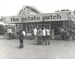 """The famous """"potato patch"""" in the center of Kennywood, where Gourmet French fries are served in a basket with an option of up to eight toppings."""