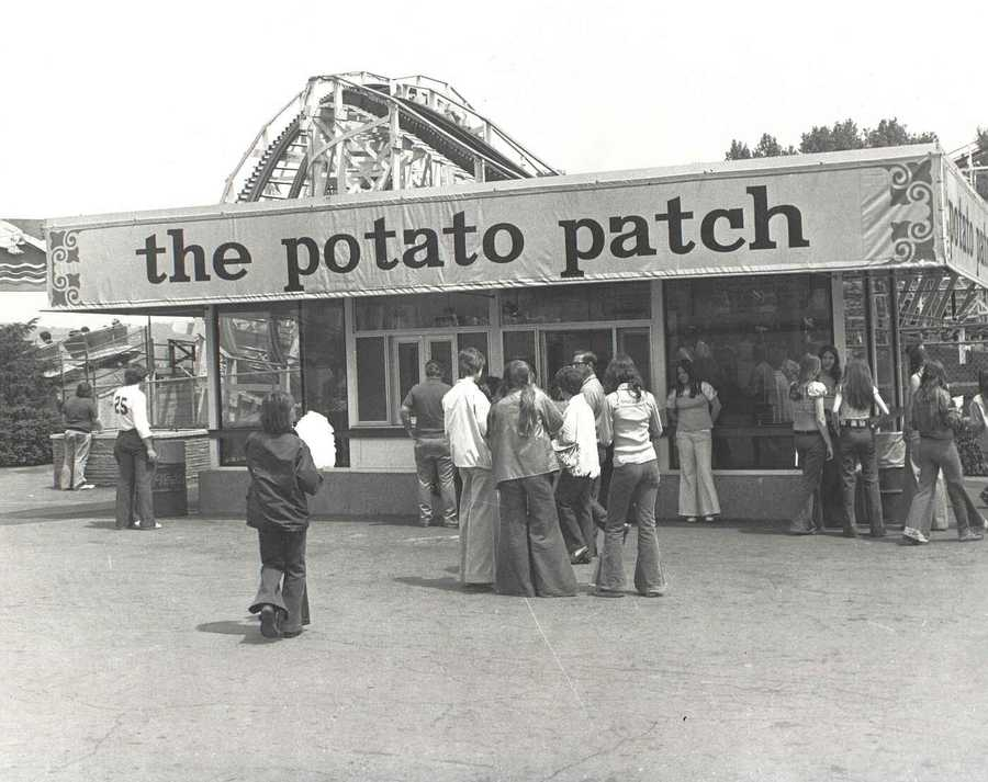 "The famous ""potato patch"" in the center of Kennywood, where Gourmet French fries are served in a basket with an option of up to eight toppings."