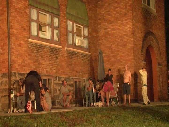 Flames were reported inside the two-story Old Main Apartment Building on Main Street around 3:15 a.m.