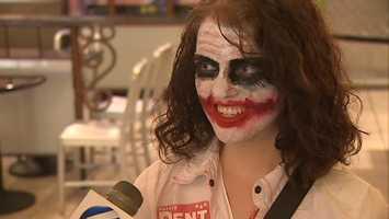 "Megan Richardson dressed like The Joker for the midnight premiere of ""The Dark Knight Rises."""