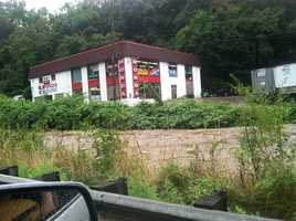 Swollen creek running past Pittsburgh Cycle Center/Honda House, just off Route 51 in Bon Air