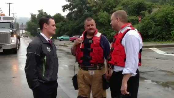 Mayor Luke Ravenstahl (left) and Public Safety Director Michael Huss (right) tour flood damage in Hays
