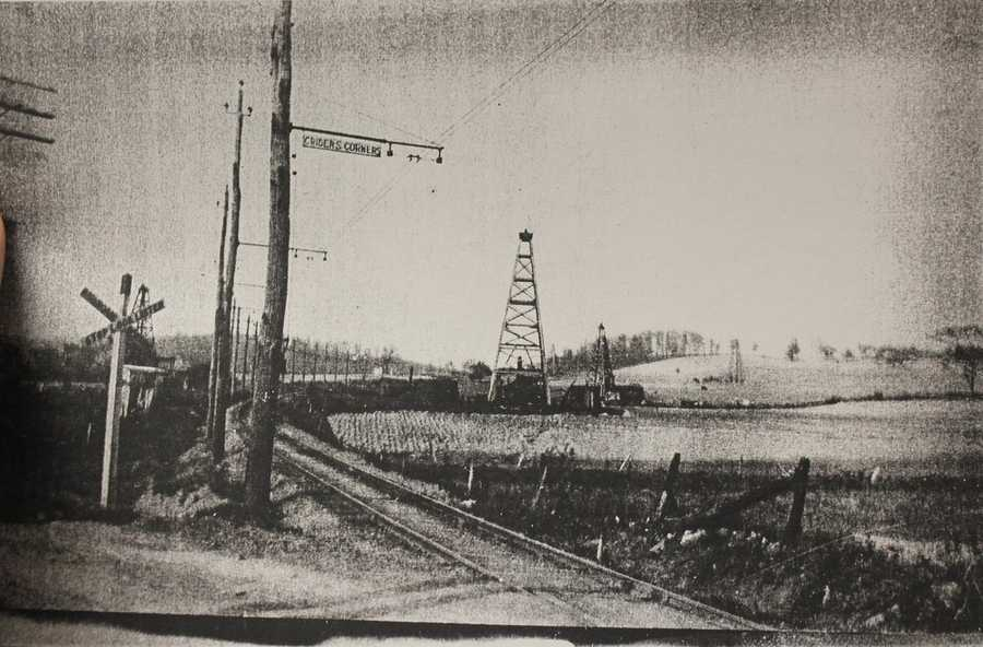 Once upon a time, that area looked like this!  This photo is from 1908, when these railroad tracks passed through the busy intersection. The crossroads were named for Jacob Crider, who purchased 50 acres of land there in 1871.