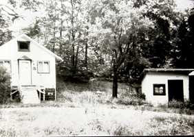 Stanley Covert's home and store, at the bottom of the hill on old Route 19, north of Glen Eden.  This photo shows what the structures looked like in 1990.