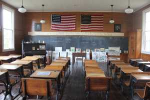 Here's a peek inside the schoolhouse. Unlike schools today, which have classrooms and teachers by the dozen, the old schools had a single classroom and teacher.