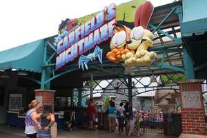 """In 2004, the ride was rethemed to """"Garfield's Nightmare."""" It was changed to be a boat ride featuring the Garfield and Odie comic strip characters. It is the world's oldest operating Old Mill."""