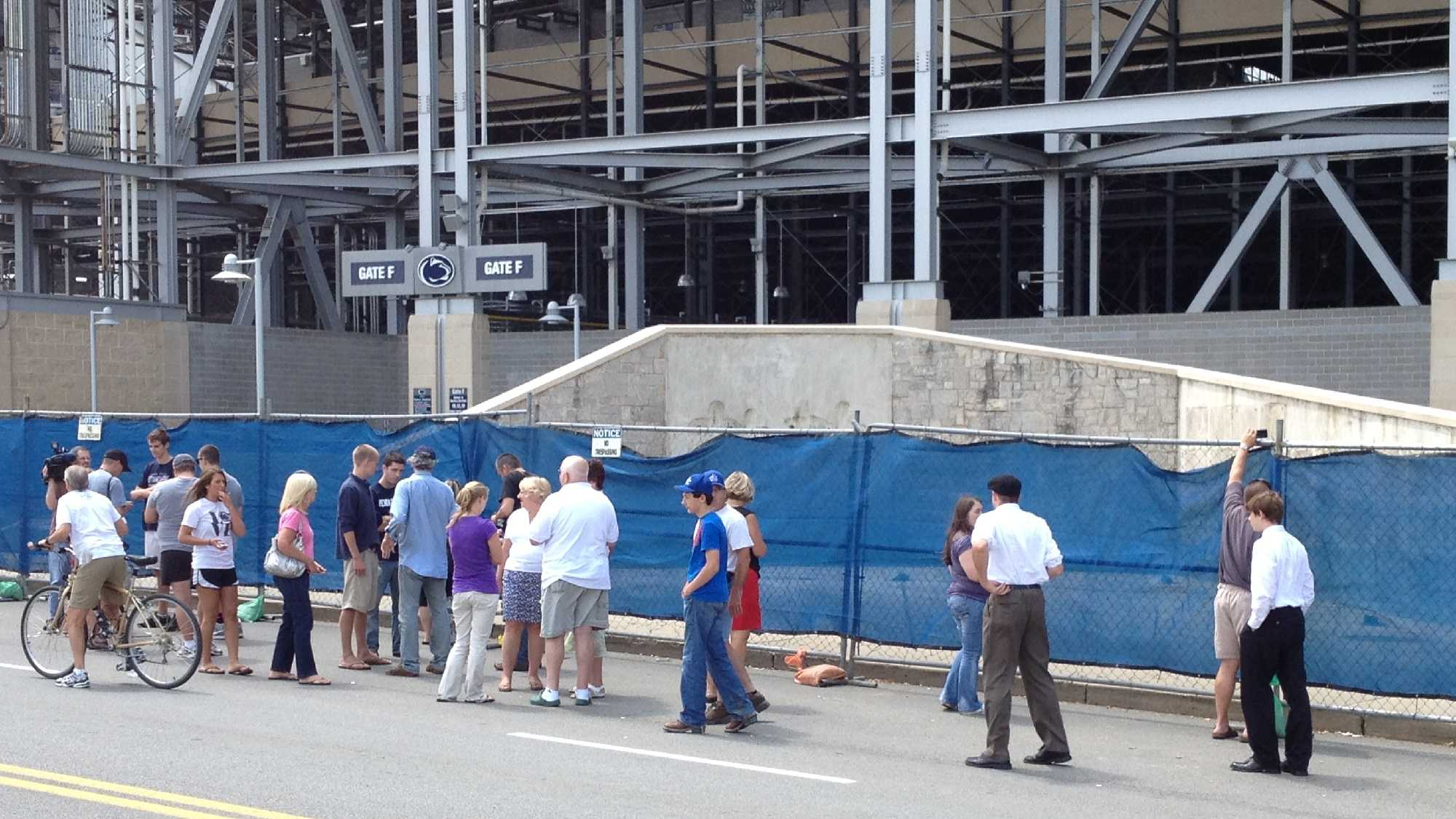 A crowd gathered around the spot where a statue of Joe Paterno stood for years outside Beaver Stadium on the Penn State University campus.