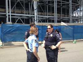 Police officers keep watch at Beaver Stadium as the Joe Paterno statue is taken down.