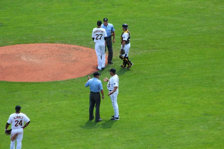 One point of controversy in the game: Did Pirates outfielder Alex Presley make a spectacular diving catch? Umps ruled against the Buccos. Clint Hurdle is pictured here receiving an explanation.
