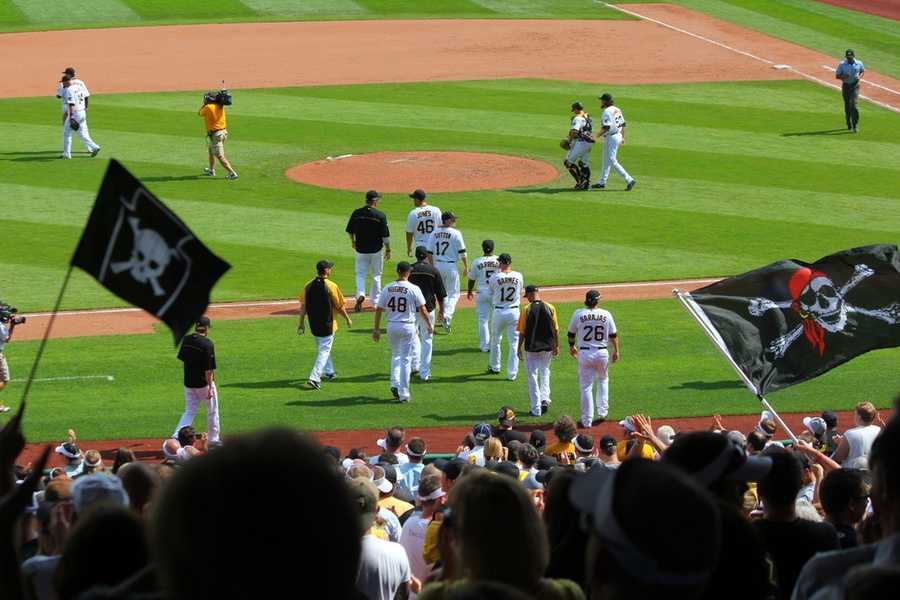 The team celebrates the victory on the field. Final Score: Pirates 3, Marlins 0.