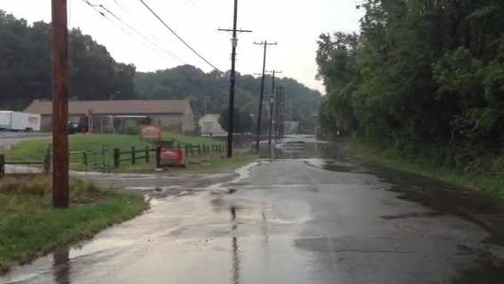 A car trapped in floodwaters on Idlewood Road in the city of Pittsburgh.