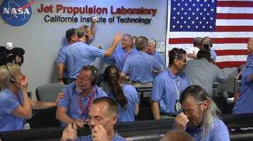 From NASA.gov:Engineers at NASA's Jet Propulsion Laboratory in Pasadena, Calif., celebrate the landing of NASA's Curiosity rover on the Red Planet. The rover touched down on Mars the evening of Aug. 5 PDT (morning of Aug. 6 EDT)