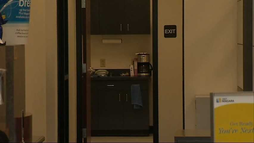The robber ordered employees into a vault and fled through a back door.