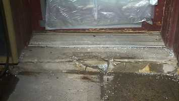 Broken glass was seen outside the damaged front door.