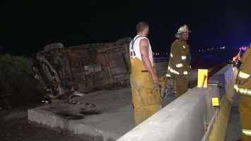 The car ended up on the wrong side of the road on an overpass after the accident in the westbound lanes.
