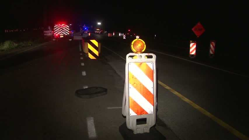 Three people were pulled out of a vehicle that crashed in a construction zone on Interstate 376.
