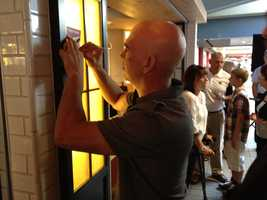 Michael Symon signs autographs at the opening of his restaurant, Bar Symon, at Pittsburgh International Airport.