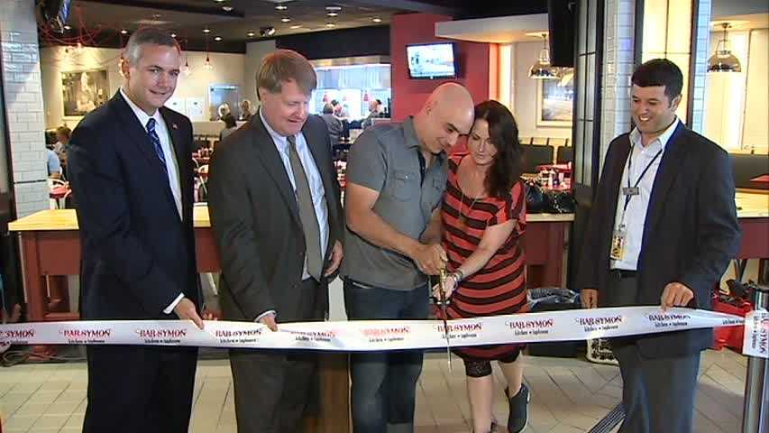 Celebrity chef Michael Symon celebrated the grand opening of his new restaurant at Pittsburgh International Airport.