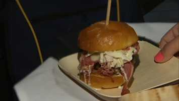 Signature dishes include the Lola Burger topped with a fried egg and pickled red onions.