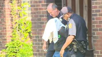 Police took a woman in Wilkinsburg away for questioning.