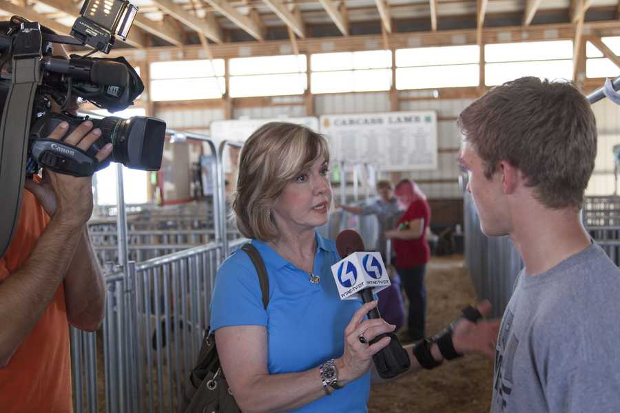 Channel 4 Action News anchor Sally Wiggin interviews Nate Painter at the Westmoreland Fair