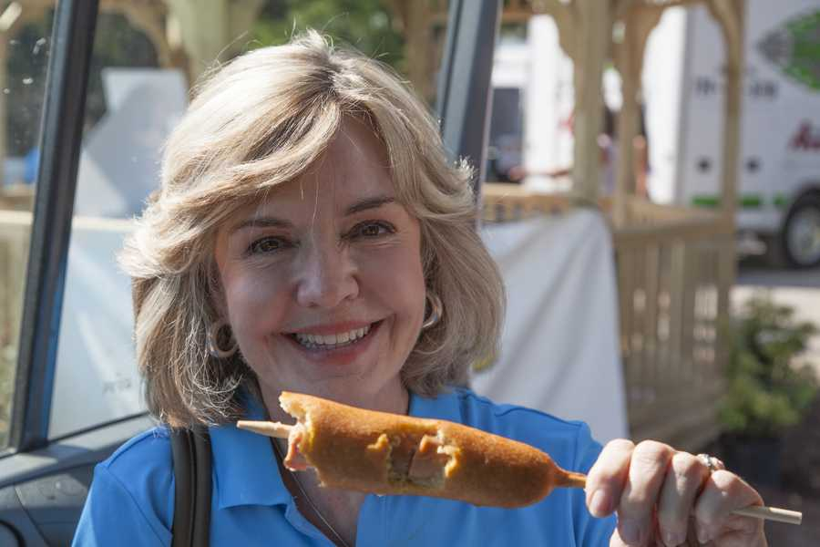 Channel 4 Action News anchor Sally Wiggin enjoying a corn dog at the Westmoreland Fair