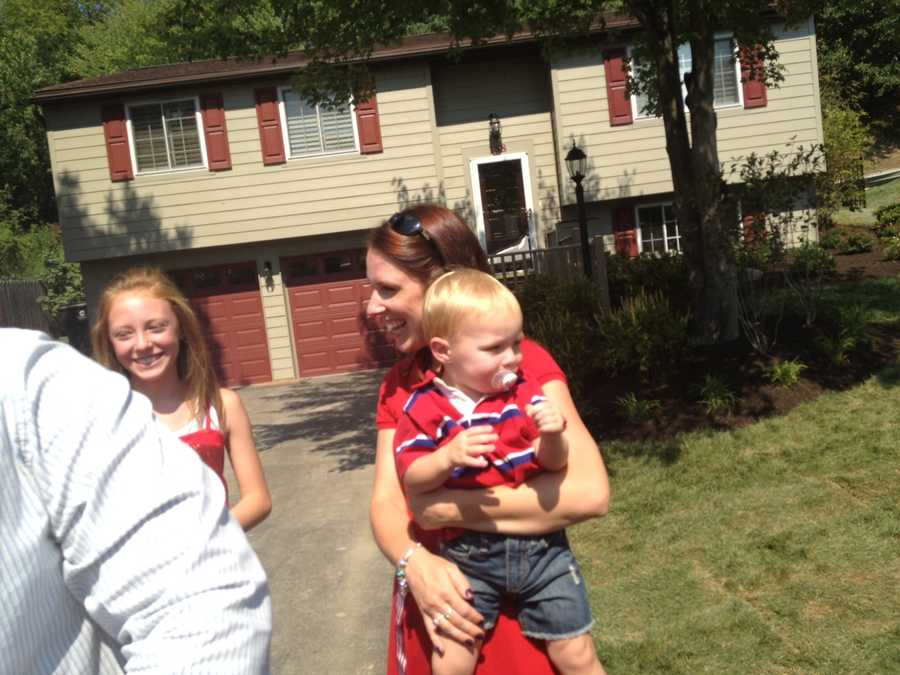 Kelly Caskey holds her 1-year-old son