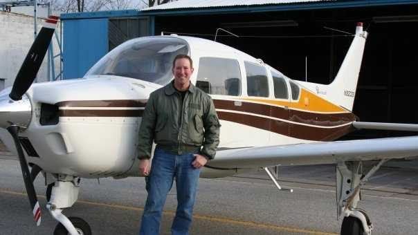 Brian Hall with his 1975 single-engine Beechcraft