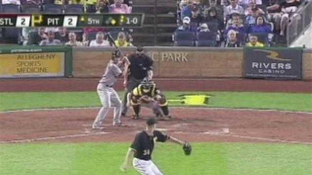A.J. Burnett pitches to Matt Carpenter